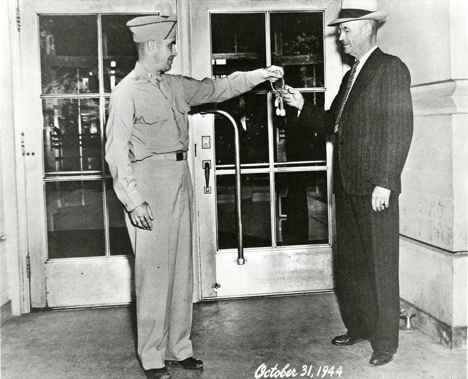 At the end of the WSCS activities, the Army returned the keys of the campus to Controller Ira Smith (right), chief acting university officer, 1944 October 31