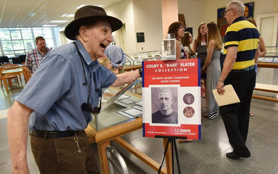 Edward Slater joins the University Library's July 30 celebration of his uncle Colby E. 'Babe' Slater, the Aggie who won two Olympic gold medals playing rugby for the United States nearly a century ago. (Wayne Tilcock/The Davis Enterprise)