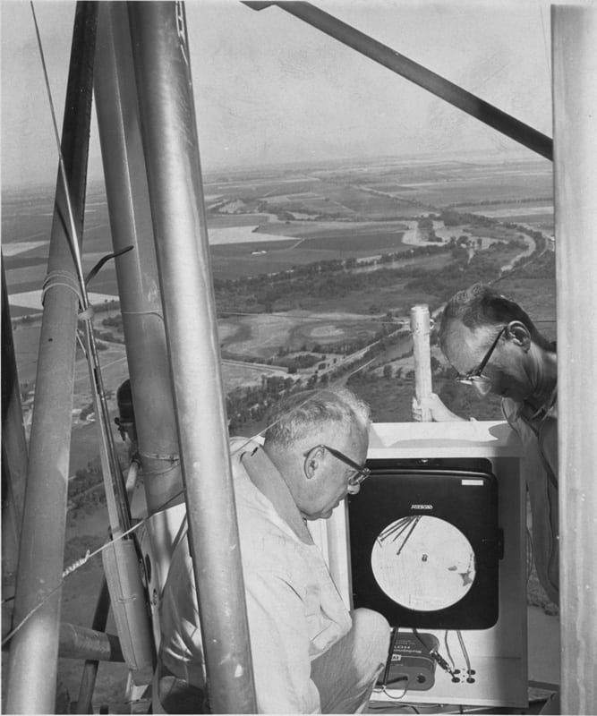 Coby Lorenzen (left) and H. Schultz on a television tower in Walnut Grove, California, circa 1950s.