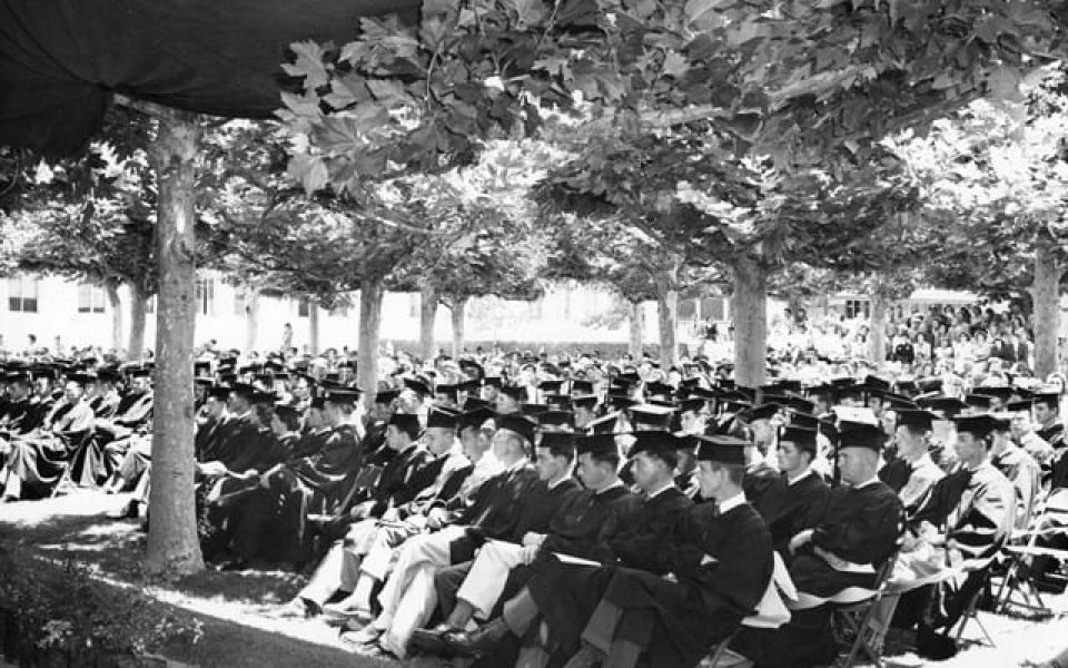 First graduation of four-year students in the Sunken Garden. Students are facing west.