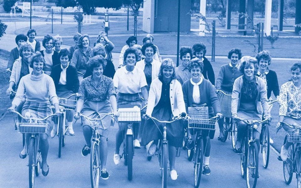 1962 publicity photo intended to show UC Davis as a bicycle friendly campus. Chancellor Emil Mrak led an initiative to create a network of bike paths around the campus.