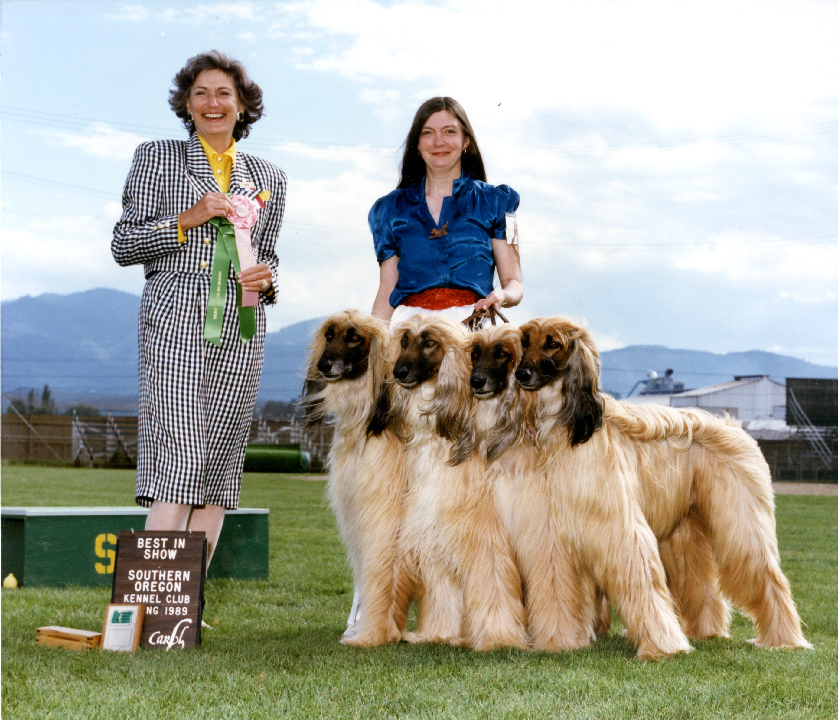 Sheila Grant and her four Afghan hounds are awarded Best in Show at the Southern Oregon Kennel Club dog show in 1989