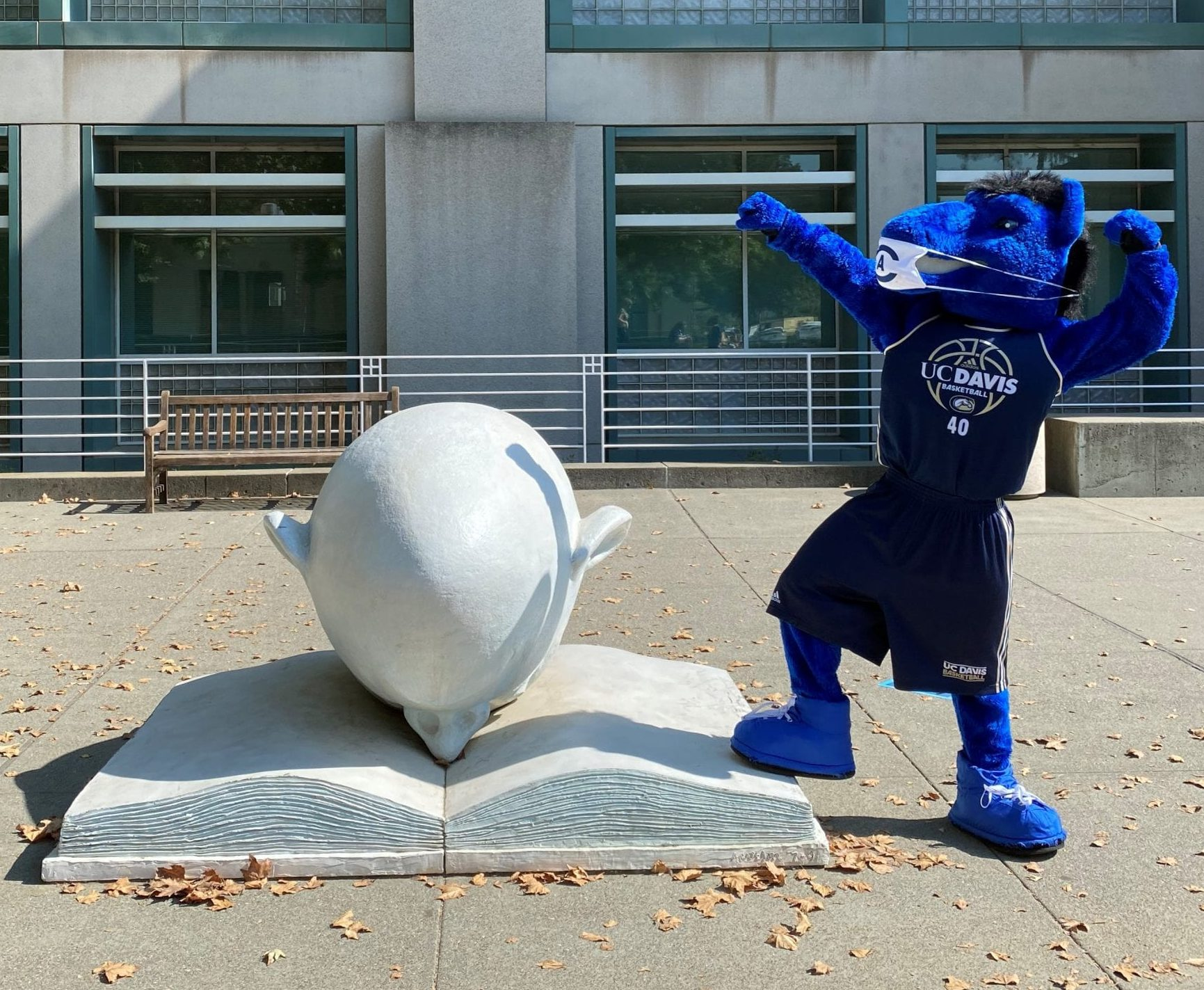 Gunrock strikes a pose with the Bookhead outside Shields Library